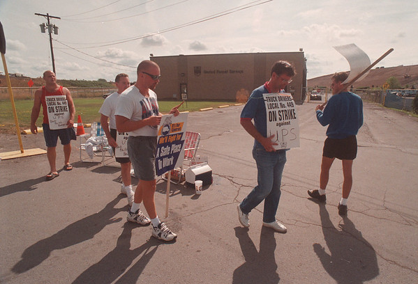 97/08/04 UPS Picketing - James Neiss Photo -  UPS workers picket infront of the Packard Road facility.