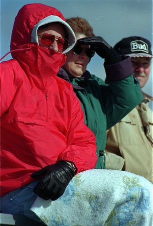 5/16/97-- weather pic--Takaaki Iwabu photo-- Steve and Debbie Turkovich bundle up themselves as they watch a larosse game at Niagara Wheatfield High School Friday afternoon. (High, cold wind was continued Friday...) <br /> <br /> 1A, Saturday, clr.