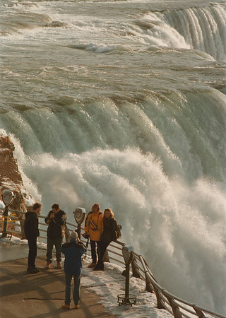 98/01/23-- Niagara Falls --Takaaki Iwabu Photo -- Tourists enjoy the view of American Falls Sunday. (For Glynn's story on lack of ice around the falls this winter.... ) <br /> <br /> local, bw, Monday