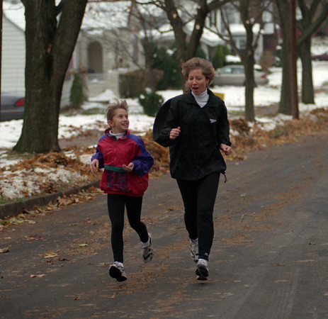 97/11/19 Jacob Runners - James Neiss Photo - L-R - Kristen Jacob 9yrs and Loretta Jacob often run together as a family.