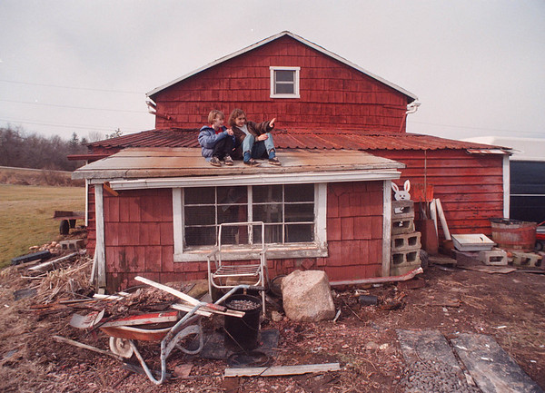 2/21/97 Grandpas Farm - James Neiss Photo - L-R - Beautiful Weather brought out  Cousins, Tori Blandin 8yrs of Berlin, Mass and Ashley Reminder 10 of Rochester, who said this is their special place, sitting on top of the  chicken coop roof of their grand father Clarence Bish's home on Lower Mt. Road at Baer Rd.