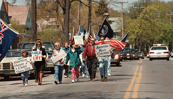 5/11/97--WALK FOR LIFE--DAN CAPPELLAZZO PHOTO--NF POLICE HOLD UP TRAFFIC ON MAIN STREET SUNDAY AFTERNOON AS WALK FOR LIFE ACTIVISTS HEAD DOWN MAIN STREET TO THE RAINBOW BRIDGE.<br /> <br /> 1A