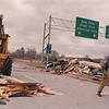 2/27/97-- wind accident 4 --Takaaki Iwabu photo-- Workers from Oakgrove Construction clears the way of R. Moses High Way after the trailor-office for construction got blown away by the wind.