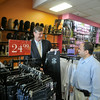 110510 Diva Beauty 2 - NGJames Neiss/staff photographerNiagara Falls, NY - Hizam Alsamma, owner of Diva Beauty on Market Street, right, shows off the designer jeans for sale at his store to Mayor Paul Dyster.