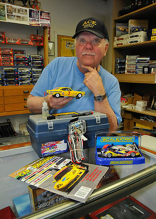 James Neiss/staff photographerNiagara Falls, NY - Ace Hobby owner Ron Shatzel, said slot car racing with 1/32 scale model cars is one of the less expensive hobbies to get into. Some of the basic beginner components include a car, controller, screw driver, racing oil, spare tires, toolbox and a trade magazine, all that can be had for under $100. Race days are Monday 6 p.m. - 9 p.m. for advanced no magnet racing and Saturday from 10 a.m. - 5 p.m. for stock magnet racing, better suited to novices, Shantzel said.