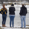 James Neiss/staff photographerNiagara Falls, NY - Bystanders watch Emergency personnel checking the waters of Hyde Park Lake after pulling a man out of the frigid water.