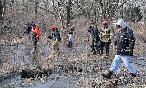 James Neiss/staff photographerNiagara Falls, NY - Volunteers search the area east of 102nd Street for the missing Judy Burr. Her body was found shortly after the search began in the dense brush.