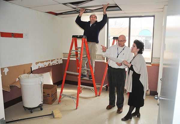James Neiss/staff photographerWheatfield, NY - Construction Manager Eddie Kurdic guts the room, left, as Stephen Schinnagel, Vice President of Hospice Services at Niagara HOSPICE and Northgate Health Care Facility Administrator Terry Collins, look over plans for one of the new Hospice Rooms under construction at the Northgate Health Care Facility on Nash Road.