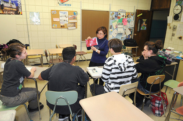 James Neiss/staff photographerLewiston, NY - Wang Ying, a visiting teacher from Tianjin NO. Two High School in China, teaches Chinese as a Second Language to students at Lewiston-Porter High School as part of a special program through the UB Confucius Academy. The students from right are, Alicia ughe, Stephen Rhodenizer and John McIntyre and Sarah Wright.