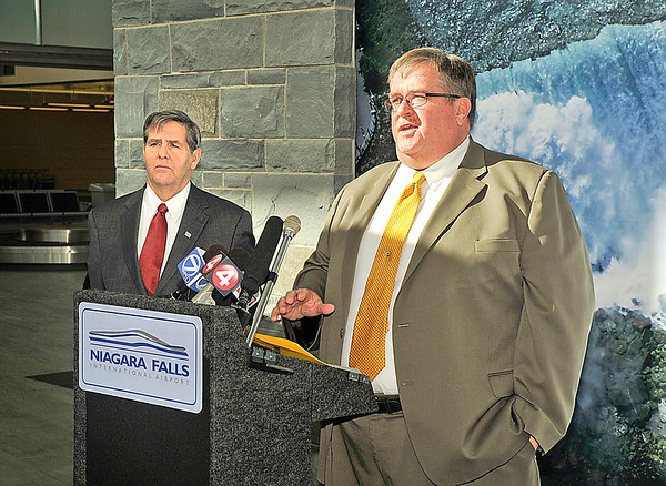 James Neiss/staff photographerWheatfield, NY - Niagara Military Affairs Council Chairman Merrell Lane, left, and Vice Chairman John Cooper held a press conference at the Niagara Falls International Airport to express their disappointment in the announcement by the USAF concerning the loss of aircraft and flying mission for the 107th Airlift Wing at the Niagara Falls Air Reserve Station.