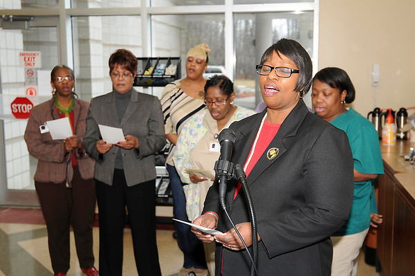 James Neiss/staff photographerNiagara Falls, NY - Brenda Caldwell, right, leads in singing the black national anthem during a celebration of Black History Month at Mount St. Mary's Hospital.