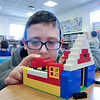 James Neiss/staff photographerLewiston, NY - Budding architect Malachi Masur 10, gives his imagination a workout during Lego Building Day at the Lewiston Library. Kids of all ages built what every they could with the popular building blocks.