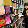James Neiss/staff photographerLewiston, NY - Linda Hageman of Wilson browses the Friends of the Lewiston Public Library book sale, looking for a good read for herself and to give to her grandchildren, she said.