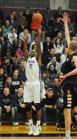 James Neiss/staff photographerLewiston, NY - Niagara University #11 Ameen Tanksley puts one up during basketball game actions against Canisius at the Gallagher Center.