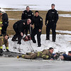 James Neiss/staff photographerNiagara Falls, NY - Niagara Falls Fire Fighters pull a man from the freezing water of Hyde Park Lake after a witness said a man fall through the ice trying to retrieve one of his dogs.