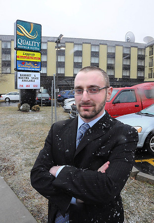 James Neiss/staff photographerSanborn, NY - Braving a sudden snow storm, Christopher J. MacKendrick, General Manager of the Quality Hotel & Suites in Niagara Falls, poses outside his First Street hotel.