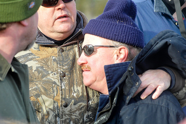 James Neiss/staff photographerNiagara Falls, NY - Dennis Toth is comforted by a friend after a body they believe to be his sister Judith Burr was found in the woods just east of 102nd Street after an extensive search by volunteers.