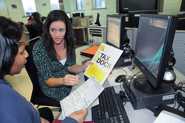 James Neiss/staff photographerNiagara Falls, NY - The Buffalo CASH Project Manager Katie Lyons, right, helps Tiffany Brown, 20, of Niagara Falls, prepare her very first income tax return at the SUNY ATTAIN Lab inside the Doris W. Jones Resource Building. Creating Assets, Savings & Hope (CASH) is a program that features discussion on fiscal literacy and free tax preparation.