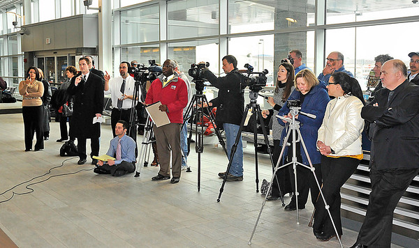 James Neiss/staff photographerNiagara Falls, NY - Members of the media ask questions after a press conference with Nick Wallenda at the Niagara Falls International Airport.