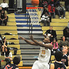 James Neiss/staff photographerNiagara Falls, NY - Niagara Falls #10 Jermaine Crumpton puts the ball up in the first quarter of basketball action against North Tonawanda.