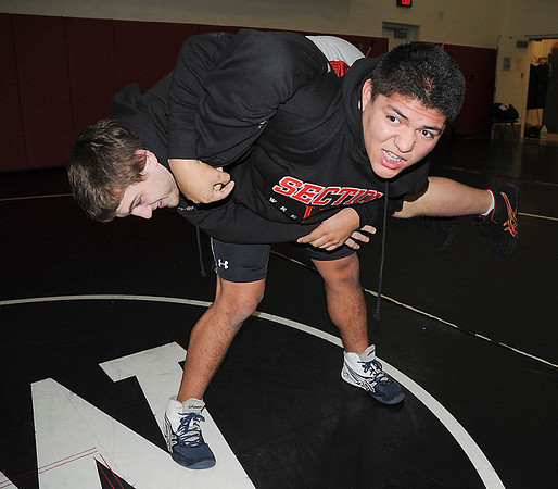 James Neiss/staff photographerSanborn, NY - Niagara Wheatfield wrestler Max Antone balances teammate Jake Kelly before taking him down during practice.