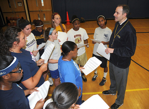 James Neiss/staff photographerNiagara Falls, NY - Niagara Falls High School girls basketball coach Mike Esposito talks with his team during practice.