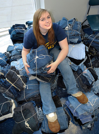 James Neiss/staff photographerNiagara Falls, NY - Niagara Falls High School student Irene Barry, 17, sits on pile of jeans, part of over 2500 pairs collected for charity. Niagara Falls High School teamed up with the clothing store Aeropostal in the Teens For Jeans program that distributes jeans to the homeless or less fortunate.