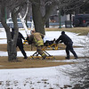 James Neiss/staff photographerNiagara Falls, NY - Emergency personnel rush a man to a waiting ambulance after being pulled from Hyde Park Lake. Niagara Falls Fire Fighters pulled the man from the freezing water after a witness said he fell through the ice trying to retrieve one of his dogs.