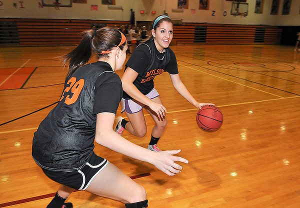 James Neiss/staff photographerWilson, NY - Wilson High School girls basketball player Jamie Curry drives the ball past teammate Emily Lasher during practice.