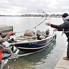 "James Neiss/staff photographerYoungstown, NY - Good Day on the Water: Joel Feagin of Cambria, left and Micah Hanford of Niagara Falls take their boat out of the water at the Old Fort Niagara docks. The two were taking advantage of the mild February weather for a day of fishing on the Niagara River and Lake Ontario. ""It was an excellent day, good color on the water and nice weather. We caught and released about 20 Lake Trout and a dozen Brown,"" said Feagin."