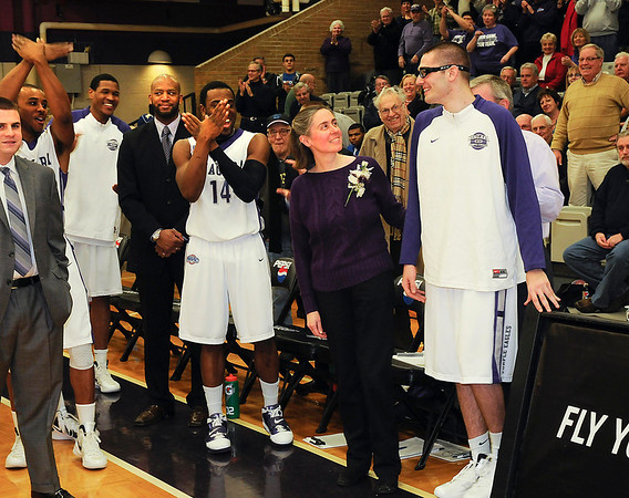 James Neiss/staff photographerLewiston, NY - Teem mates chant Bird Man as Niagara University Senior  walk-on Paul Kowalski, joined by his mother Patricia and father Peter, are honored before the last home game of the season against Canisius.