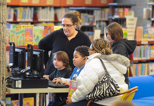 James Neiss/staff photographerNiagara Falls, NY - The Children's Library at the Niagara Falls Public Library was busy on Tuesday after an early school dismissal. Taking advantage of the computers are, from left, Jolene Kress, her son Orion 6, plus daughter Tabitha, 10, behind and Elijah Williams, 10, next to his mother Amber Douglas, right.