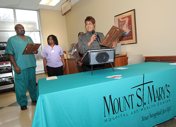 James Neiss/staff photographerNiagara Falls, NY - Nursing Supervisor DeLois Wooten, right, awarded Mount St. Mary's employees Doug Adams, left, and Shirley Hood, center with the 2012 Black History Employee Recognition award during a celebration of Black History Month at Mount St. Mary's Hospital.