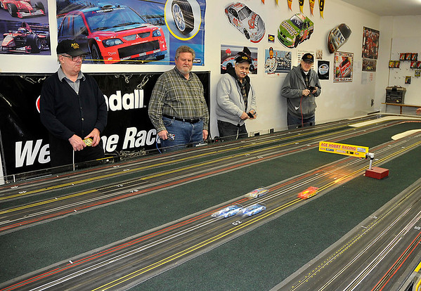 James Neiss/staff photographerNiagara Falls, NY - The slot cars are a blur as racers, from left, Steve Barnes, Tom Lauth, Al Patterson and Dan O'Grady race to Finnish first.