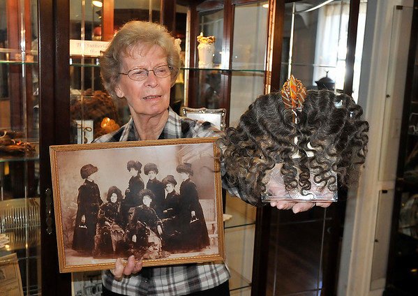 """James Neiss/staff photographerLockport, NY - Niagara County Historical Society volunteer Joan Barry shows off just a few of the items featured in and exhibit entitled """"It's A Good Hair Day,"""" opening on Saturday Feb. 18, from 1-3 at the Historical Society featuring lots of """"long-haired entertainment all centered around the lives of the Seven Sutherland Sisters. The Seven Sutherland Sisters, a group of singing ladies from Lockport/ Niagara, N.Y., were famous for their long hair, which they showed off in a sideshow of Barnum & Bailey's from about 1882 to 1907."""