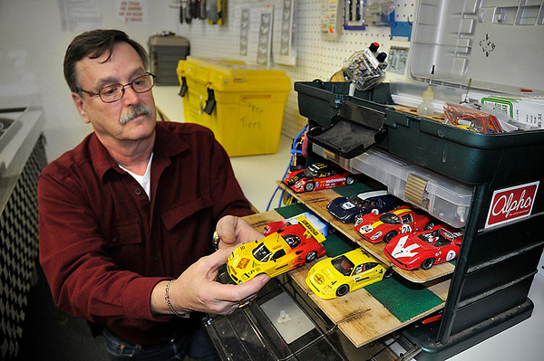 James Neiss/staff photographerNiagara Falls, NY - Chris Briggs of Honeoye Falls drives 90 miles every Monday to race his slot cars on the Ace Hobby racetrack.