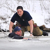 120215 Hyde Park Lake 4 - NGJames Neiss/staff photographerNiagara Falls, NY - Lead by Example: Niagara Falls Fire Battalion Chief Dan Boland jumped into the ice waters of Hyde Park lake to rescue a man that fell through the ice trying to retrieve one of his dogs.