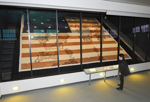 James Neiss/staff photographerYoungstown, NY - Gerando Meza of Chicago, views the historic Old Fort Niagara large garrison flag that was captured by British Troops in 1813.  It was later found at the ancestral home of Sir Gordon Drummond, commander of the British troops that captured it in 1994, when it was purchased by the Old Fort Niagara Association and put on display at the forts visitor center.