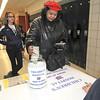 James Neiss/staff photographerNiagara Falls, NY - Shirley Cullins of Niagara Falls makes a donation during Children's Hospital Night at Niagara Falls High School before the basketball game between Niagara Falls and North Tonawanda.