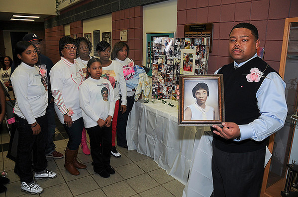 James Neiss/staff photographerNiagara Falls, NY - Larry Wallace, right, holds a photo of his grandmother Zenobia Hamilton-Williams who was struck by a car and killed on December 28, 2011. The family held a fundraiser at the Doris Jones Family Resource Building to raise reward money they hope will help in finding the driver that killed her. Family members at left are, Maranda Hall, Joseph Hamilton, daughter Donna Owens, daughter Rene Williams, Mahogani Lewis Shawntel Williams, Lakeisha Gantt and baby Major Smith.