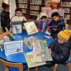 James Neiss/staff photographerNiagara Falls, NY - Brothers and sisters, from left, Ny-Fia Szopinski, 8, Chester Bradley, 10, Diamond Szopinski, 4, Antonio Szopinski, 9, and Malachi Swanson, 3, enjoy the selection books on black history at the Niagara Falls Public Library as part of the Black History Month celebration in the Children's Library.