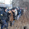 James Neiss/staff photographerNiagara Falls, NY - Volunteers line up at arms length before the search.