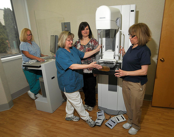 James Neiss/staff photographerNiagara Falls, NY - Niagara Falls Memorial Medical Center Mammography Technologists, from left, Gloria Gwozdek, Debbie Perkins, Cori Cosgrove and Margaret Martello train on a brand new full field digital mammography system at the Summit Healthplex. The system does away with film featuring advanced digital imaging.
