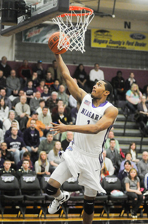James Neiss/staff photographerLewiston, NY - Niagara University #1Malcolm Lemmons puts one up during basketball game actions against Canisius at the Gallagher Center.