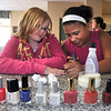"James Neiss/staff photographerNiagara Falls, NY - Aimee Burns, 10, gets her nails polished by Amira Moor, 10, during a ""GEMS"" Club nail polish party. The GEMS, Girls Enjoy Memorizing Scripture, meet every Tuesday for fun and instruction at the Denny's Kitchen Hope Club on Niagara Street. The restaurant dining room is transformed into a ministry center after hours Monday - Friday at 2:00 p.m. just before school lets out."
