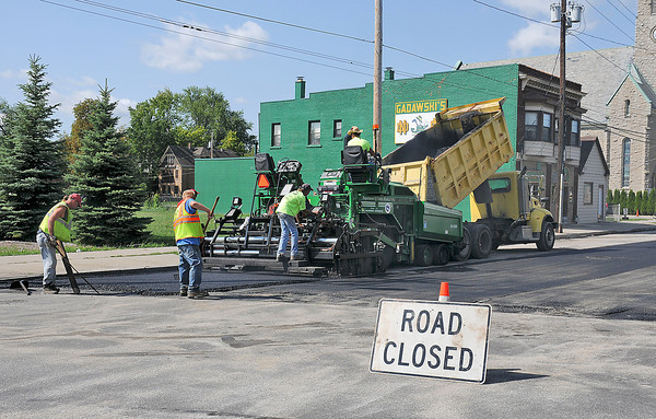 James Neiss/staff photographerNiagara Falls, NY - Niagara Falls DPW crews pave sections of Old Falls Street just west of Portage Road.