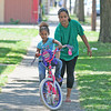 James Neiss/staff photographerNiagara Falls, NY - Brooklyn Hunt, 5, gets a little help getting started on her first day without training wheels. Brooklyn and her mother Frances Galarza were practicing her new bicycle riding skills in front of their 24th Street home.