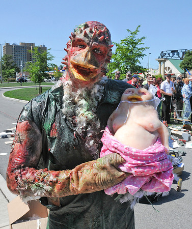 James Neiss/staff photographerNiagara Falls, NY - Kevin The Wonder Duck is a proud Papa behind the scenes of the Troma Entertainment film Return To The Class Of Nuke'Em High being filmed on the front lawn of the Niagara Arts and Cultural Center.