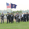 James Neiss/staff photographerWilson, NY - A Color Guard leads the Johnson family to a memorial service for their daughter and sister Sarah Johnson who died when their home was destroyed by a propane explosion. The service was held at the Wilson Soccer Complex.