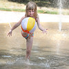 James Neiss/staff photographerYoungstown, NY -  Little Lauren Fura plays with a beach ball in the splash pool at Falkner Park where the Village of Youngstown is have a Community Picnic on Saturday.